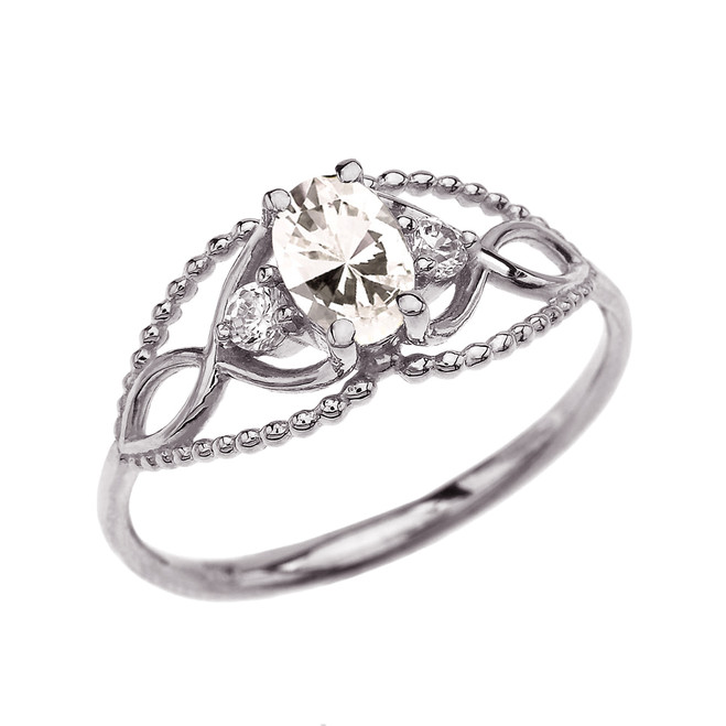Elegant Beaded Solitaire Ring With April Birthstone CZ Centerstone and White Topaz in White Gold