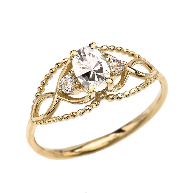 Elegant Beaded Solitaire Ring With April Birthstone CZ Centerstone and White Topaz in Yellow Gold