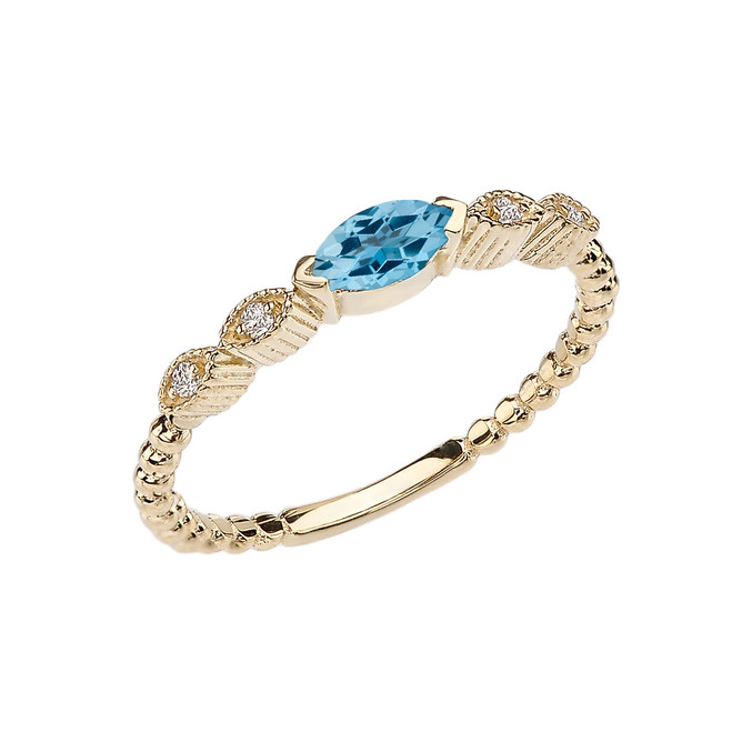Blue Topaz and Diamond Marquise Cut Engagement/Proposal Beaded Ring in Yellow Gold