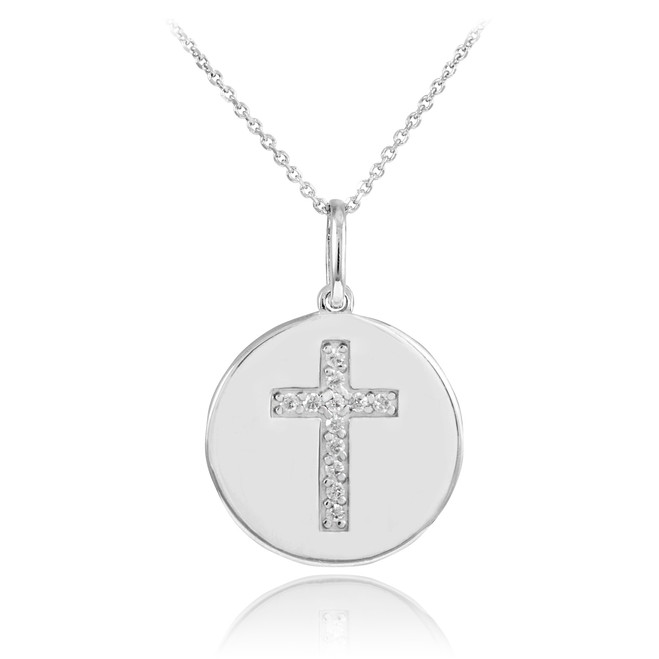 Cross disc pendant necklace with diamonds in 14k white gold.