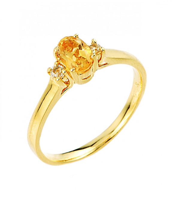 Citrine November birthstone and white topaz gemstone ring in gold.