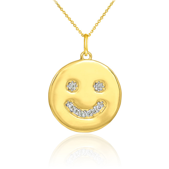 Smiley face disc pendant necklace with diamonds in 14k yellow gold.