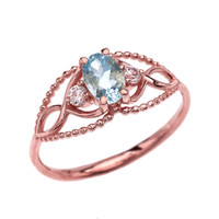 Elegant Beaded Solitaire Ring With Aquamarine Centerstone and White Topaz in Rose Gold