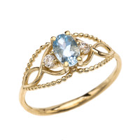 Elegant Beaded Solitaire Ring With Aquamarine Centerstone and White Topaz in Yellow Gold