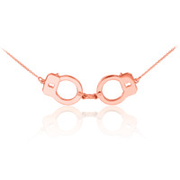 Handcuffs necklace in 14k rose gold.