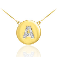 """Letter """"A"""" disc necklace with diamonds in 14k yellow gold."""