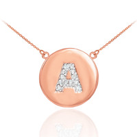 """Letter """"A"""" disc necklace with diamonds in 14k rose gold."""
