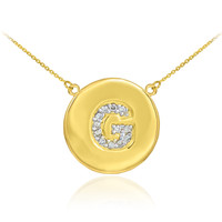 """Letter """"G"""" disc necklace with diamonds in 14k yellow gold."""