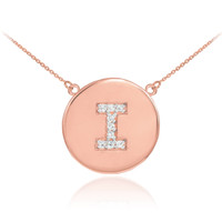 "Letter ""I"" disc necklace with diamonds in 14k rose gold."