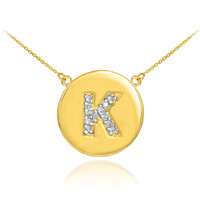 """Letter """"K"""" disc necklace with diamonds in 14k yellow gold."""