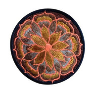 Small embroidered patch with abstract floral design (3 inches)