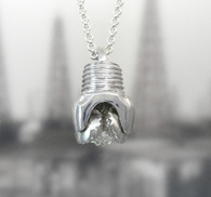 Drill bit on medium-heavy STERLING SILVER rolo link chain