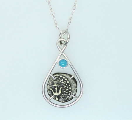 Symbols on this side feature double cornucopias, palm branch, and circle containing anchor.  The feature stone is a 4mm round cabochon turquoise.
