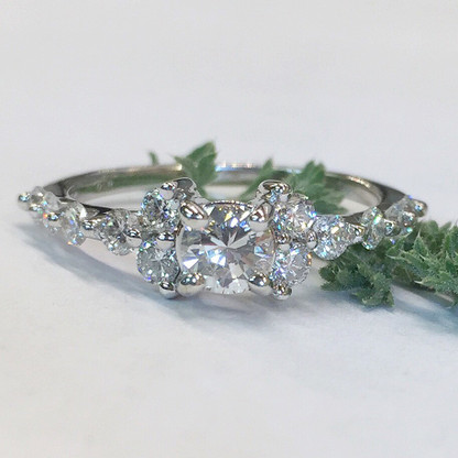 The BRITNEY engagement ring features a unique style of common-prong stone setting which makes the diamonds stand out from the shank of the ring