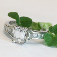 The EMMYLOU engagement features unique trapezoid and step-cut square diamond accents channel-set into the 3.15mm wide shank.