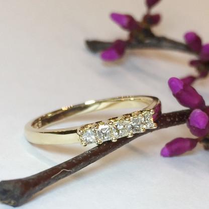 The PILAR Diamond Band features 5 Princess Cut diamonds graded I/SI2