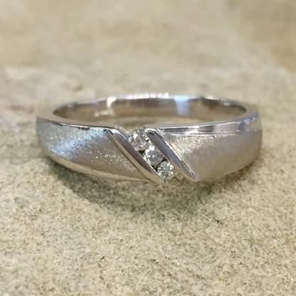 The MATT wedding band features 3 channel-set round brilliant diamonds.
