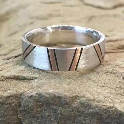 Continuum© Sterling Silver & Rose Gold Band feature one of a kind random inlays of 14K Rose Gold