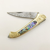 Damascus blade, brass body and bolsters, Abalone inlay
