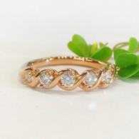 """The SARAH diamond band with .39carats total weight diamonds in """"S"""" shape settings"""