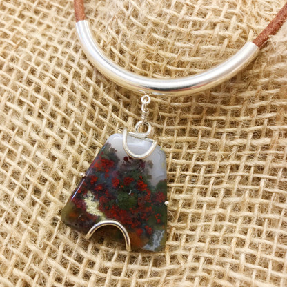 """Moss Agate approximately 1"""" x 1"""" - Green and Red Colors - Sterling Silver Frame - Sterling Silver Tube Slide Hanger - 4mm Natural Leather approximately 20"""" -  Pendant entirely hand-crafted by TKP Craftsman Jay Phinney"""