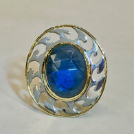 Our LABRADORITE AND STERLING SILVER RING has a feel of motion in the cut-out top