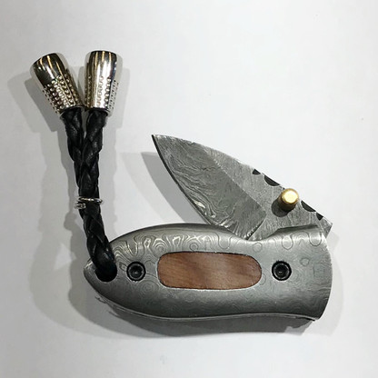"LUXURY KNIFE QGKND1210 features:  4.0"" Long (open), Damascus Blade (over 250 layers), Brass Stud Open Assist, Damascus Steel with Olive Wood Inlay Handles, File-work on Brass Bolster Linings"