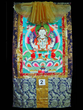 """Chenrezig - Thangka #2 Chenrezig is the mode of being of the mind that is the union of emptiness and compassion. He is the awakened nature of each being's own mind, the love and compassion primordially present in pure transcending awareness. Chenrezig is within us because love and compassion are not qualities added to the mind. These qualities are part of the awakened state even if, for the moment, this state exists only as a potential for us. He is the visible expression taken by all the Buddhas to help activate the love and compassion that are presently only a potential in us and to reveal the ultimate Chenrezig to ourselves. Chenrezig may be the most popular of all Buddhist deities, except for Buddha himself -- he is beloved throughout the Buddhist world. As Chenrezig, he is considered the patron Bodhisattva of Tibet, and his meditation is practiced in all the great lineages of Tibetan Buddhism. The beloved king Songtsen Gampo was believed to be an emanation of Chenrezig, and some of the most respected meditation masters (lamas), like the Dalai Lamas and Karmapas, who are considered living Buddhas, are also believed to be emanations of Chenrezig. His mantra, famous over all of Asia, is OM MA NI PAD ME HUNG Measures 29"""" x 53"""", image 20"""" x 28"""". Item #FSE-TT02."""