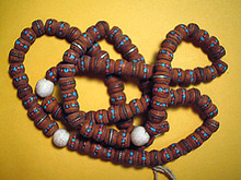 This Genuine Bodhi Seed Mala has tiny bits of genuine turquoise and coral embedded in each bead, imparting a feeling of strength.