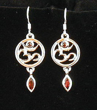 These beautiful Om earrings are made of sterling silver with garnets. We are impressed with the quality.