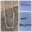 Actress Melissa Joan Hart's three children each wrote their names to creat this necklace for her.