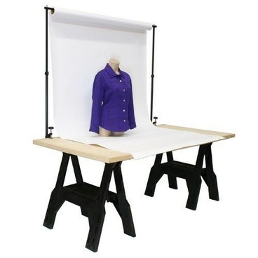 The table top background support set-up with background hangin from center pole and table.
