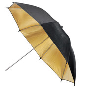 An opened gold umbrella showing its reflective inside and black outside.