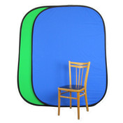 erected pop-up backdrop resting against a prop chair.