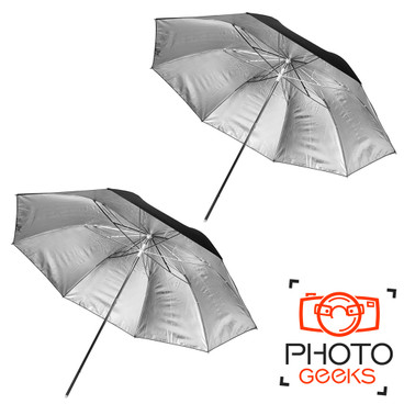 An underneath view of two silver umbrellas, showing the reflective surface.