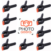 Ten plastic clamps and photogeeks logo