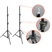 Two erected light stands with three zoomed in images to the side, showing the spigot, nut fastning and tripod fastening details.