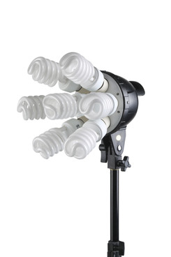 Front view of the light head with seven bulbs screwed into its face.