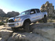 Pro Comp 57002B Uniball Upper A Arms with Billet Dust Cap Installed On A Toyota Tacoma 4wd
