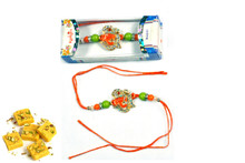 Divine OM Ganesh With Sweets Rakhi To India,USA America Buy Online Store-Free Shipping,Cheap Rates,Fast Delivery
