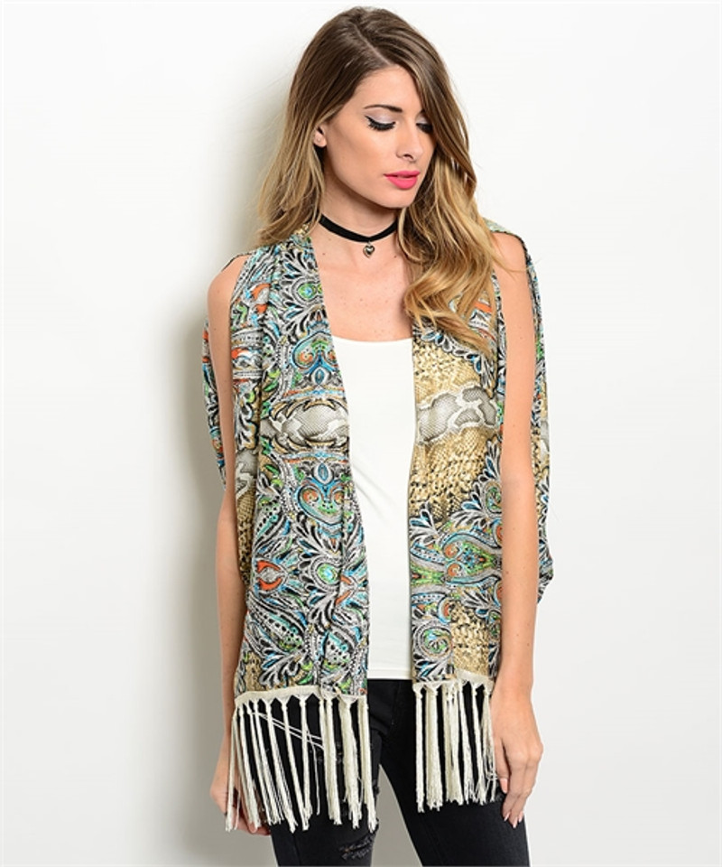 Boutique Poncho Vest is Boho Earth Tone Paisley with Fringe Tassels.