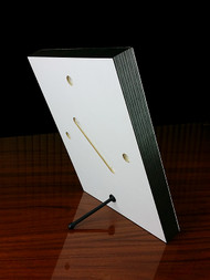 The back of the 8x10 panel showing the included stand and pre-drilled mounting holes.