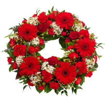 Red flowers sympathy wreath for sweden delivery, it includes red gerberas.