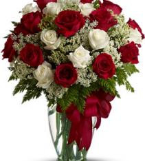 Red and white roses arranged with greenery and red ribbon sweden flower local delivery.