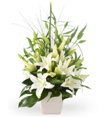 Premium flower arrangement of white oriental lilies for sweden delivery.