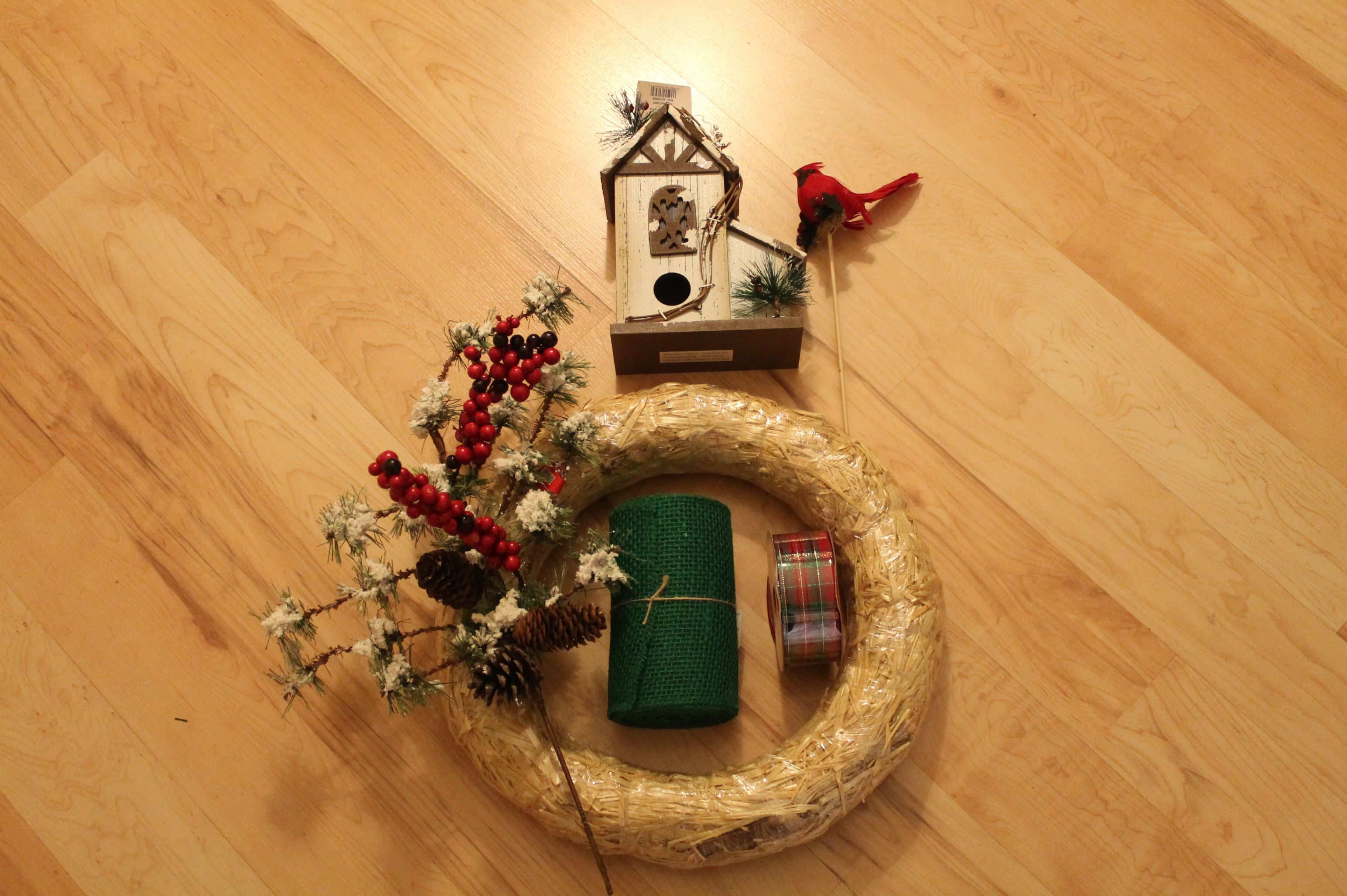 gather the end of the burlap place the gather on the straw wreath and push a floral pin through the burlap into the straw wreath very simple - Burlap Christmas Wreath