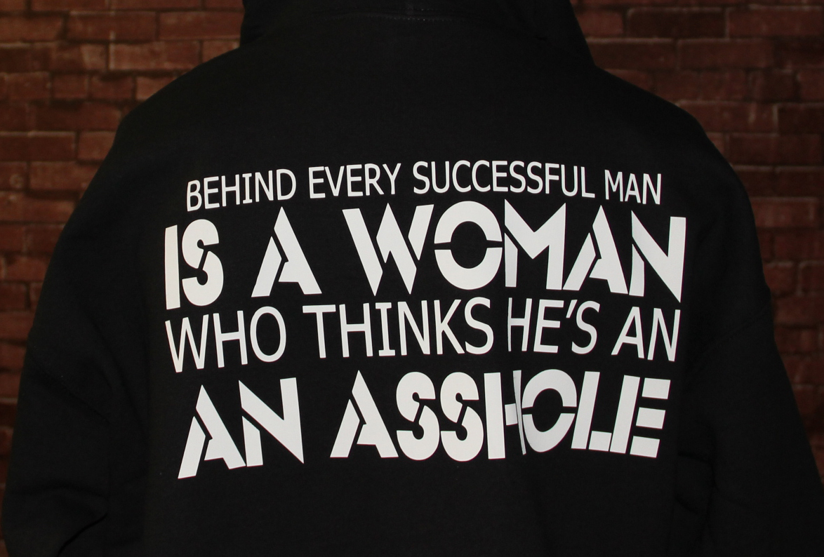 behind-every-sucessful-man-is-a-woman-who-thinks-hes-an-asshole-t-shirts.jpg