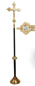 The budded cross measures twenty-four inches tall.  It is finished a combination silver and gold finishes and features a seven-inch Corpus with a high polish silver finish.  The cross is attached to a staff measuring eighty-eight inches tall.  The staff is powder coated with a durable black and gold vein finish.   A weighted brass base provides stabilty for this Crucifix.