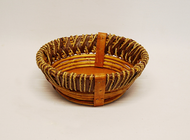 "This basket is a small rustic style round basket. The small rustic basket measures 10"" dia x 4 "" deep. Lightweight and easy to handle!"