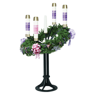"""This beautiful and traditional advent floor wreath is the perfect addition to any church.  Features: Get this advent wreath in black matte or satin gold coated finish. This floor advent wreath comes with options to add a brazier and a ring. The standing advent wreath comes with three inch candle sockets, but you can specify a different socket diameter (1½"""" through three inches only). Early Christian traditions established the use of the advent wreath and advent candles in anticipation of the birth of our Lord. The circular advent wreath represents the eternity of the blessed Trinity, without beginning or end. This rendition, with its 34 inch ring will enhance any worship area and is angled for a more visible presentation to the congregation. Aesthetically balance with either traditional solid colored candles or banded artisan wax candles as pictured.  Details: Base levelers and individual socket leveling devices. 35"""" aluminum wreath Dimensions: 24"""" base and 54"""" height to base of candle socket. 18"""" Steel Base 48"""" Greenery Wreath and susspension iwries included Candles and extra decorations are NOT included Order your church's standing advent wreath today. This beautiful and traditional advent candle holder is a great choice!"""